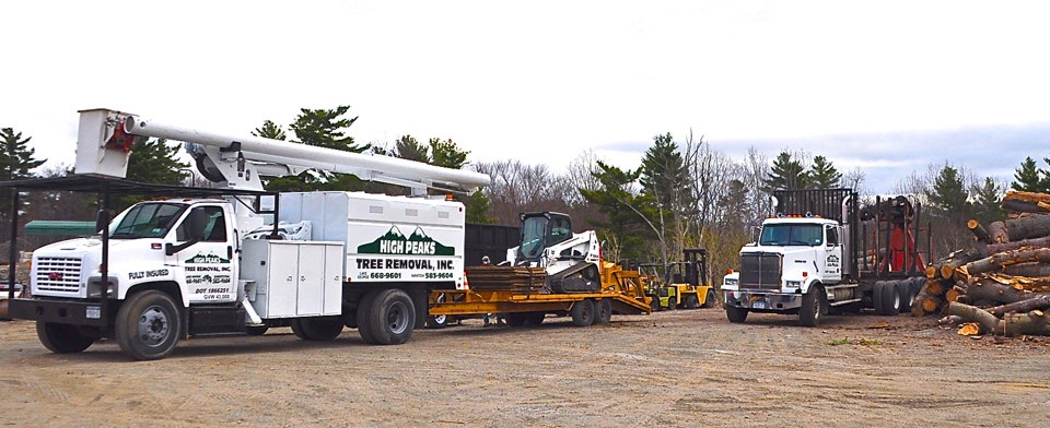 high peaks tree removal bucket truck bobcat log truck